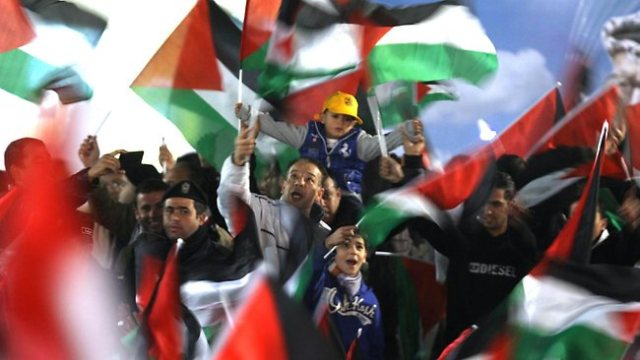 Palestinians celebrate in Ramallah on November 29, 2012 after the upgrade of Palestine's status at the United Nations by the UN General Assembly.