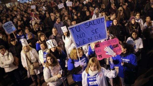 Protesters take part in a demonstration organized by health workers to denounce budget cuts and privatizations in health service in Madrid on November 27, 2012.