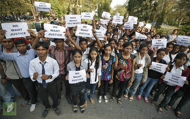 Demonstrators hold placards during a protest in the western Indian city of Ahmedabad December 29, 2012. (Reuters/Amit Dave)
