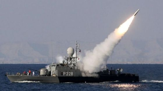 The file photo shows an Iranian military boat firing a rocket during the 10-day Velayat 90 naval exercise launched on December 24, 2011.