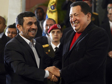 Venezuelan President Hugo Chavez (R) and Iran's President Mahmoud Ahmadinejad. (AFP Photo / Juan Barreto)