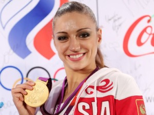 Russian gymnast Yevgenia Kanaeva, gold winner of the rhythmic gymnastics individual all-around competition, at a news conference in the media center of the Russian Olympic venue Russia Park, London (RIA Novosti / Ekaterina Chesnokova)