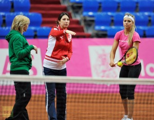 From left: Russian national women's tennis team coaches Larisa Savchenko-Neiland and Anastasiya Myskina with tennis player Mariya Kirilenko during a training session of the Russian national women's team before the 2012 Fed Cup semifinal match in Moscow. (RIA Novosti/Alexey Kudenko)