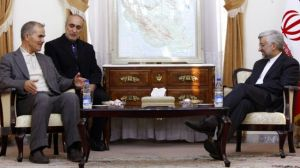 Secretary of Iran's Supreme National Security Council Saeed Jalili (R) meets with Tunisian Minister of Higher Education and Scientific Research Moncef Ben Salem in Tehran on December 3, 2012.