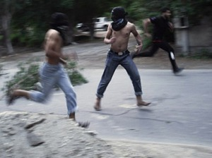 Bahraini Shiite Muslim protestors run for cover from tear gas and bird shots fired by riot police during clashes in the village of Karranah, West of Manama, on November 30, 2012. (AFP Photo / Mohammed Al-Shaikh)