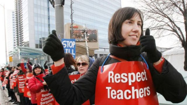Teachers in Canada's Ontario are seen during a one-day strike against a bill that would freeze their salaries and strip them of their collective bargaining rights, December 18, 2012.