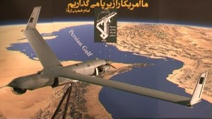 The US ScanEagle drone captured by Iran over the Persian Gulf waters in Iranian airspace is seen on display against the background of a Persian Gulf map, December 4, 2012.