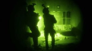 US Special Operations forces search a home during a nighttime raid in Afghanistan. (File photo)