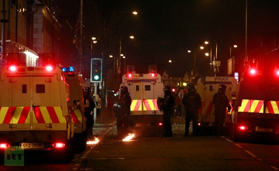 Armour-plated police Jeeps are attacked by youths throwing petrol bombs in East Belfast, after a decision was made to remove the British flag from Belfast's City Hall January 4, 2013. (Reuters / Cathal McNaughton)