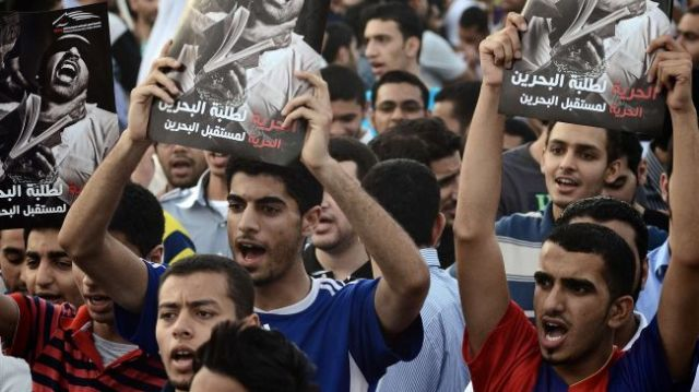 Bahraini protesters call for freedom during a demonstration in the village of Jidhafs, west of Manama, April 27, 2012.