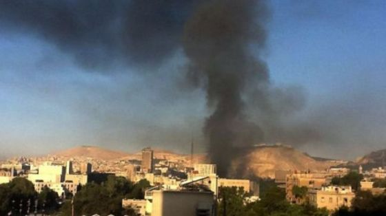 File photo shows the scene of a bomb attack near the Syrian capital, Damascus.