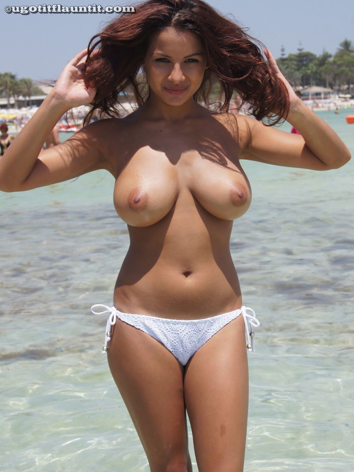 This huge hot boobs topless on the beach