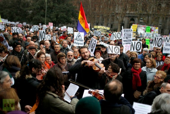 Musicians perform during a protest against the local government's plans to cut public healthcare spending in Madrid January 7, 2013. (Reuters / Juan Medina)
