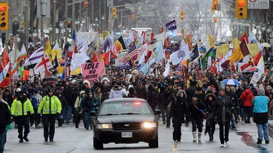 Native protesters march up Wellington Street in Ottawa, Canada, Friday, January 11, 2013.