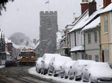 A snow plough is driven through Henley in Arden, central England January 18, 2013.(Reuters / Darren Staples)