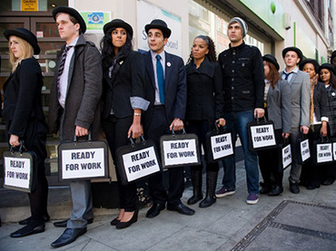 Unemployed young people stand in line outside a job centre in central London. (AFP Photo / Leon Neal)
