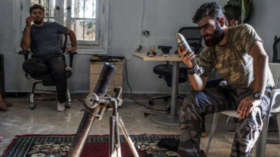 A mortar shell from the former Yugoslavia in seen in the hand of a militant in Syria. (File photo)