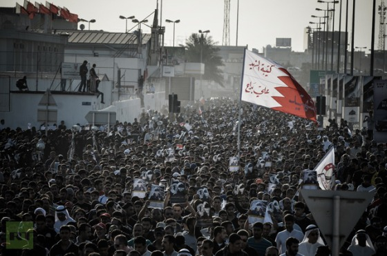 Bahraini take part in the funeral of Hussain Ali Al Jazeeri, a teenager killed in protests marking the second anniversary of a Shiite-led uprising, on February 16, 2013 (AFP Photo / Mohammed Al-Shaikh)