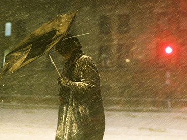 A pedestrian makes his way through driving snow with a broken umbrella in the Back Bay neighborhood on February 8, 2013 in Boston, Massachusetts (Mario Tama / Getty Images / AFP)