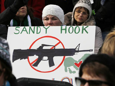 People hold signs memorializing Sandy Hook Elementary School as they participate in the March on Washington for Gun Control. (Reuters / Jonathan Ernst)