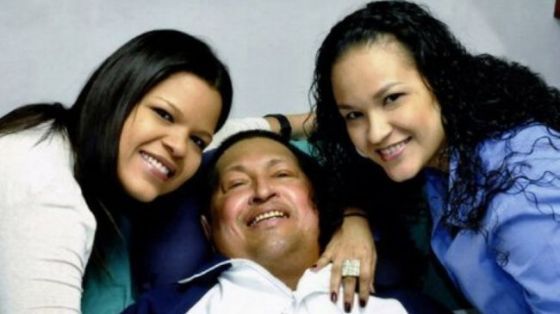 Photo shows Venezuela's President Hugo Chavez surrounded by his daughters at hospital in Havana on February 15, 2013.