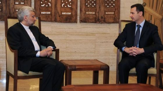 Syrian President Bashar al-Assad (R) talks with Secretary of Iran Supreme National Security Council Saeed Jalili in Damascus, February 2, 2013.