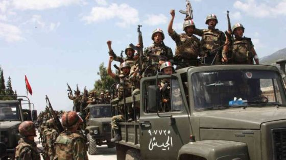 Syrian soldiers enter a village near the town of Jisr al-Shughour, Idlib governorate. (file photo)