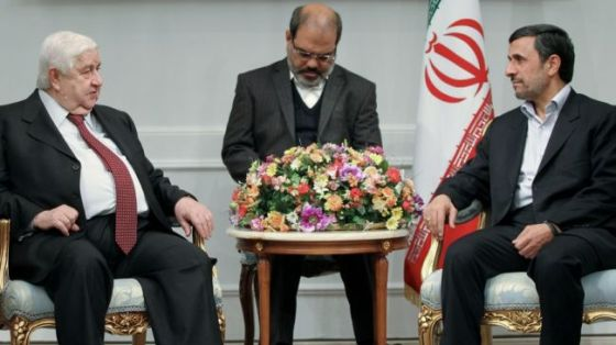 Iranian President Mahmoud Ahmadinejad (R) meets Syrian Foreign Minister Walid al-Muallem in Tehran on March 2, 2013