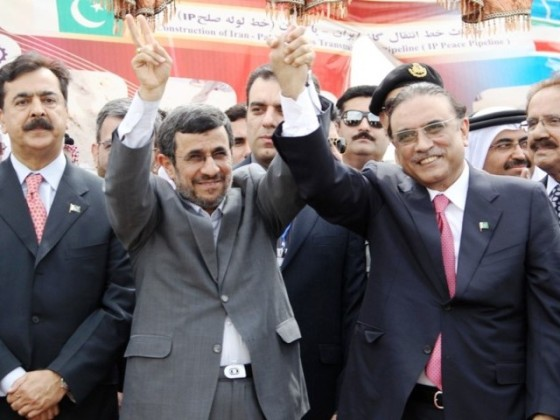 Iran's President Mahmoud Ahmadinejad (L) shakes hands with Pakistan's President Asif Ali Zardari during a ceremony marking the start of work on the 780-kilometre (485-mile) pipeline from Iran to Pakistan. PHOTO: AFP