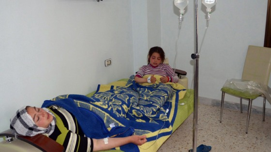 Woman and a girl rest on a mattress at a hospital in the Khan al-Assal region in the northern Aleppo province, as Syria's government accused rebel forces of using chemical weapons for the first time on March 19, 2013 (AFP Photo / HO-SANA)