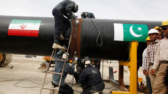 Irani workers weld the pipeline during a groundbreaking ceremony to mark the inauguration of the Iran-Pakistan gas pipeline, in the city of Chahbahar in southeastern Iran March 11, 2013. (Reuters/Jason Lee)