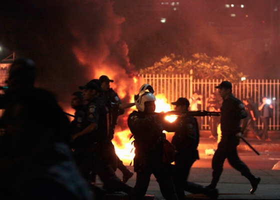 """Riot police clash with demonstrators during the """"National Day of Strikes, Stoppages and Protests"""" in downtown of Rio de Janeiro July 11, 2013 (Reuters / Sergio Moraes)"""