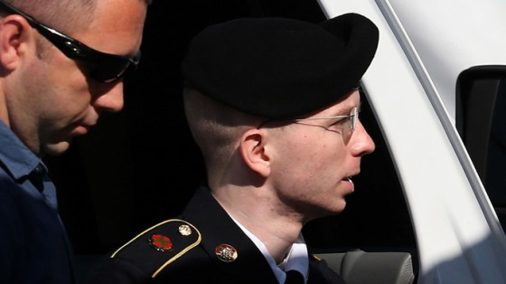 U.S. Army Private First Class Bradley Manning (R) is escorted by military police as arrives to hear the verdict in his military trial July 30, 2013 at Fort George G. Meade, Maryland. (Mark Wilson/Getty Images/AFP)