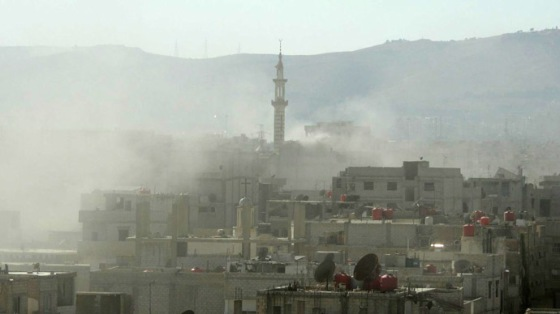 A handout image released by the Syrian opposition's Shaam News Network shows smoke above buildings following what Syrian rebels claim to be a toxic gas attack by pro-government forces in eastern Ghouta, on the outskirts of Damascus on August 21, 2013. (AFP Photo/Shaam News Network)