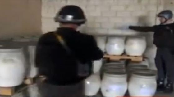 An image grab taken from Syrian television on October 19, 2013 shows an inspectors from the Organisation for the Prohibition of Chemical Weapons (OPCW) at work at an undisclosed location in Syria (AFP Photo)