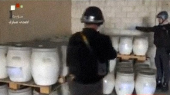 An image grab taken from Syrian television on October 19, 2013 shows an inspectors from the Organisation for the Prohibition of Chemical Weapons (OPCW) at work at an undisclosed location in Syria. (AFP/Syrian television)